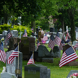 Veteran flags marking headstones at Mentor cenetery